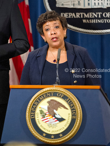 United States Attorney General Loretta E. Lynch makes opening remarks during a press conference with US Attorney Preet Bharara of the Southern District of New York at the Department of Justice in Washington, DC on Thursday, March 24, 2016.  They announced criminal charges against seven individuals working on behalf of the Iranian government for conducting cyber attacks against the US financial sector and the Bowman Dam in Rye, NY.<br /> Credit: Ron Sachs / CNP<br /> (RESTRICTION: NO New York or New Jersey Newspapers or newspapers within a 75 mile radius of New York City)