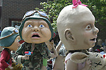 Earth babies from the Great Goddess of the Earth chase one another in the 21st annual Summer Solstice Parade held Saturday, June 20, 2009 in Seattle, Wa. The parade was held Saturday, bringing out painted and naked bicyclists, bands, belly dancers and floats. (Jim Bryant Photo © 2009).. .