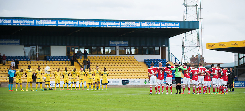 Players of both sides observe a minutes silence in memory of young Torquay United fan Ollie Lovis, who passed away recently<br /> <br /> Photographer Kevin Barnes/CameraSport<br /> <br /> Football - Pre Season Friendly - Torquay United v Newport County AFC - Saturday 18th July 2015 - Plainmoor - Torquay<br /> <br /> &copy; CameraSport - 43 Linden Ave. Countesthorpe. Leicester. England. LE8 5PG - Tel: +44 (0) 116 277 4147 - admin@camerasport.com - www.camerasport.com