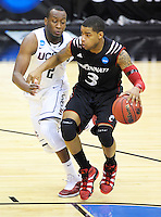 Dion Dixon of the Bearcats dribbles the ball while being guarded by Huskies' Donnelli Wilks. UConn defeats Cincinnati 69-58 during the 3rd round of the NCAA Tournament at the Verizon Center in Washington, D.C on Saturday, March 19, 2011. Alan P. Santos/DC Sports Box