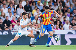Carlos Soler Barragan (r) of Valencia CF competes for the ball with Marco Asensio Willemsen of Real Madrid during their La Liga 2017-18 match between Real Madrid and Valencia CF at the Estadio Santiago Bernabeu on 27 August 2017 in Madrid, Spain. Photo by Diego Gonzalez / Power Sport Images