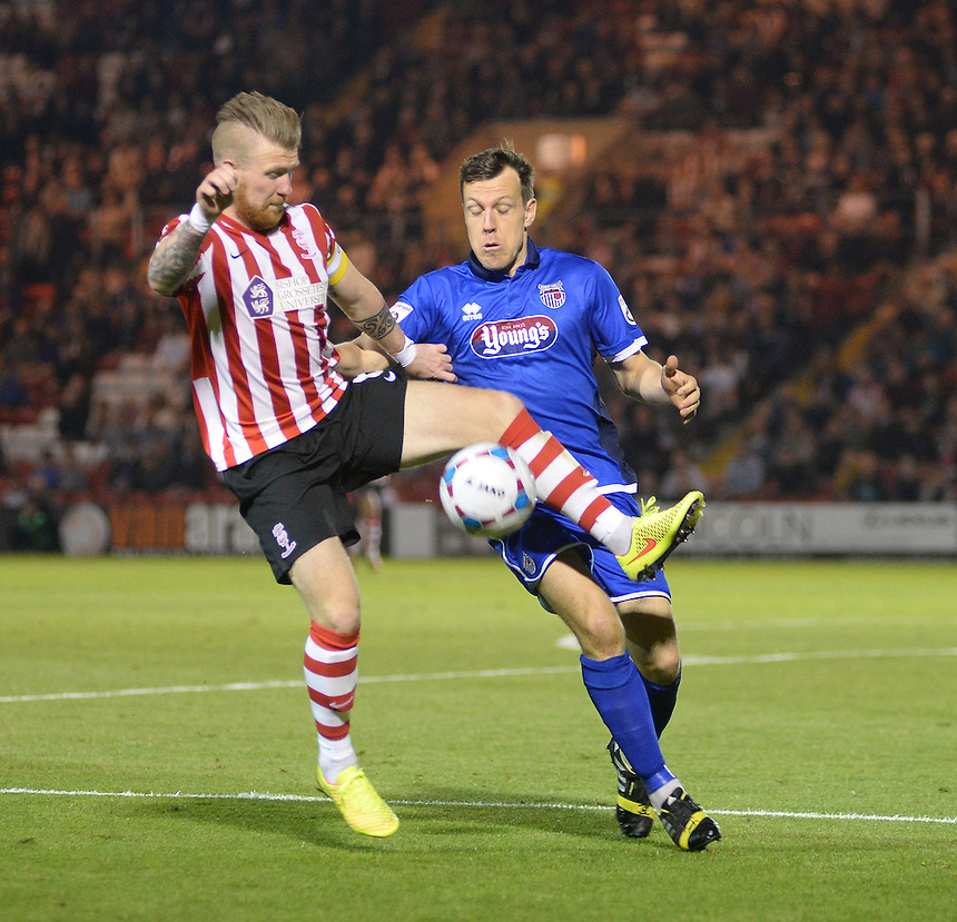 Lincoln City's Alan Power shields the ball from Grimsby Town&rsquo;s Carl Magnay<br /> <br /> Photo by Chris Vaughan/CameraSport<br /> <br /> Football - English Football Vanarama Conference Premier League - Lincoln City v Grimsby Town - Tuesdayb9th September 2014 - Sincil Bank - Lincoln<br /> <br /> &copy; CameraSport - 43 Linden Ave. Countesthorpe. Leicester. England. LE8 5PG - Tel: +44 (0) 116 277 4147 - admin@camerasport.com - www.camerasport.com