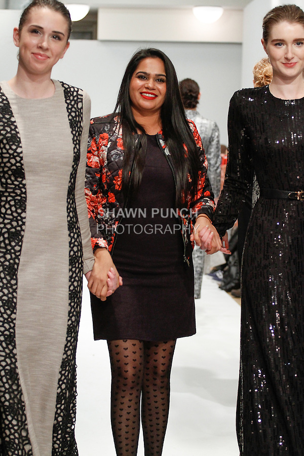Fashion designer Charu Lochan Dass walks runway with models at the close of her Charu Lochan Dass Fall Winter 2014/2015 fashion show, during Fashion Gallery Week Fall 2014, on February 9, 2014.