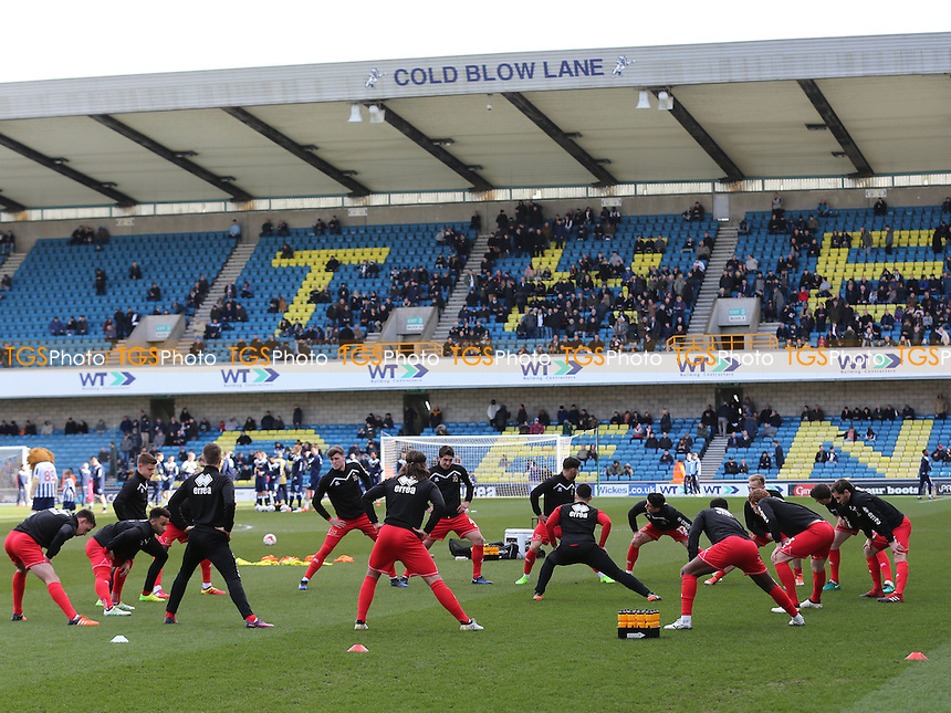 MK Dons players warm up pre-match during Millwall vs MK Dons, Sky Bet EFL League 1 Football at The Den on 4th March 2017