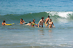 Teenagers in the water on the California coast