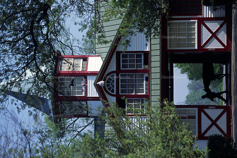 White barns with red trim add charm to ambiance at famed Calumet Farm.