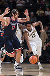 Bryant Crawford (13) of the Wake Forest Demon Deacons dribbles past Grant Golden (33) of the Richmond Spiders during first half action at the LJVM Coliseum on December 2, 2017 in Winston-Salem, North Carolina.  (Brian Westerholt/Sports On Film)