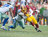 Dallas Cowboys against the Washington Redskins wide receiver Santana Moss (89) is tackled by Dallas Cowboys safety Barry Church (42) in fourth quarter action at FedEx Field in Landover, Maryland on Sunday, December 28, 2014.  The Cowboys won the game 44-17.<br /> Credit: Ron Sachs / CNP