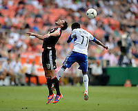 Chris Pontius (13) of D.C. United goes up for a header with Sanna Nyassi (11) of the Montreal Impact during the game at RFK Stadium in Washington DC.   D.C. United defeated the Montreal Impact, 3-0.