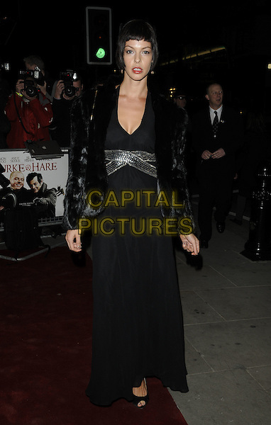 POLLYANNA McINTOSH .Attends the 'Burke and Hare' World Premiere at The Chelsea Cinema, Kings Road, Chelsea, London, England, UK, 25th October 2010..full length black fur jacket dress silver sequined sequin long maxi open peep toe shoes .CAP/CAN.©Can Nguyen/Capital Pictures.
