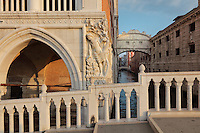 The Ponte dei Sospiri or Bridge of Sighs (right), 1600, designed by Antonio Contino, Venice, Italy. The bridge spans the Rio di Palazzo and connects the New Prison or Prigioni Nuove to the interrogation rooms in the Doge's Palace. The enclosed limestone bridge is so named as this would be the last view of Venice for prisoners on the way to their cells. On the left is a sculpture of the Drunkenness of Noah by Filippo Calendario on the corner of the Doge's Palace or Palazzo Ducale, begun 1340 and built in Venetian Gothic style. The city of Venice is an archipelago of 117 small islands separated by canals and linked by bridges, in the Venetian Lagoon. The historical centre of Venice is listed as a UNESCO World Heritage Site. Picture by Manuel Cohen