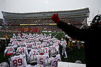 The Ohio State Buckeyes run on to the field as snow falls before the college football game between the Ohio State Buckeyes and the Minnesota Golden Gophers at TCF Bank Stadium in Minneapolis, Saturday morning, November 15, 2014. As of half time the Ohio State Buckeyes led the Minnesota Golden Gophers 17 - 14. (The Columbus Dispatch / Eamon Queeney)