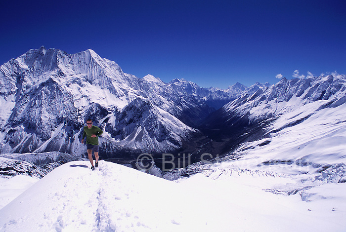 A picture if a man running in the Himalaya in Nepal. This picture was taken at 16,000 feet near the Tibetan border.