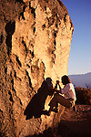 A woman rock climbing at The Buttermilks, CA.