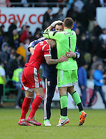 Saturday, 15 March 2014<br /> Pictured: Liam Ridgewell (L) and Ben Foster (R) of West Brom celebrating their win after the final whistle.<br /> Re: Barclay's Premier League, Swansea City FC v West Bromwich Albion at the Liberty Stadium, south Wales, UK.