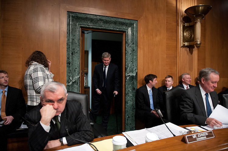 UNITED STATES - MARCh 12: Chairman Tim Johnson, D-SD., makes his way to his seat for the full committee hearing on the nominations of Richard Cordray, director of the Consumer Financial Protection Bureau; and Mary Jo White, to be a member of the Securities and Exchange Commission. (Photo By Douglas Graham/CQ Roll Call)