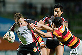 Marty Holah holds on as Kane Hancy  fights his way upfield. Air New Zealand Cup rugby game between Waikato & Counties Manukau played at Rugby Park, Hamilton, on the 17th of August , 2007. Haltime 8 - 8. Fulltime Waikato 30 - Counties Manukau 8.