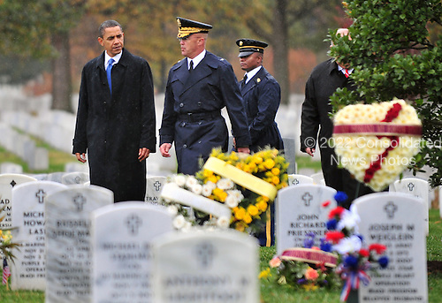 Arlington, VA - November 11, 2009 -- United States President Barack Obama, joined by General Karl Horst (C), visits section 60 at Arlington National Cemetery, in Arlington, Virginia on Veterans Day, Wednesday, November 11, 2009. Section 60 contains the grave sties of servicemen and women who were killed in Iraq and Afghanistan. UPI/Kevin Dietsch.Credit: Kevin Dietsch / Pool via CNP
