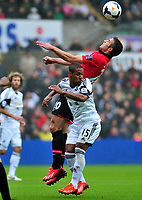 Robin Van Persie wins the header.<br />