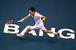 BANGKOK, THAILAND - OCTOBER 01:  Mikhail Kukushkin of Kazakhstan returns a ball to Rafael Nadal of Spain during the Day 7 of the PTT Thailand Open at Impact Arena on October 1, 2010 in Bangkok, Thailand. Photo by Victor Fraile / The Power of Sport Images