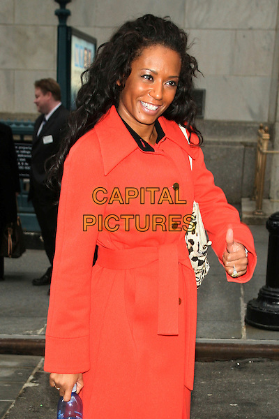 MELANIE BROWN aka MEL B .Rings the closing bell of the New York Stock Exchange.at the New York Stock Exchange, New York, NY, USA, February 2nd 2009..half length red orange coat leopard print bag scary spice belt belted .CAP/LNC.©LNC/Capital Pictures