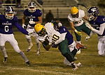 Manogue Miners running back Peyton Dixon (10) is tackled by  Spanish Springs Michael Binnell (8) on Friday night, November 9, 2018 at Spanish Springs High School in Sparks, Nevada.