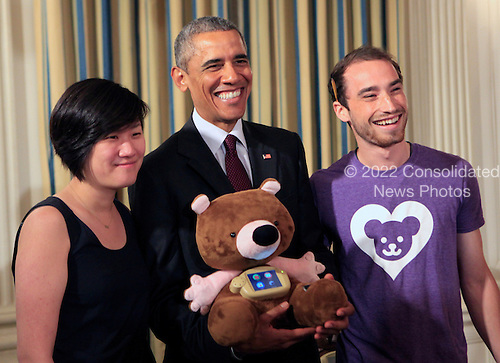 "Aaron Horowitz, right, and Hannah Chung, left, of Providence, Rhode Island show United States President Barack Obama the Sproutel company invention Jerry the Bear as the President views White House Demo Day exhibits on the state floor of the White House in Washington, DC on August 4, 2015.  Jerry the bear is a smart stuffed animal with educational apps that help kids build healthy behaviors centered on nutrition, exercise, sleep, and mindfulness. Additional modules customize Jerry to provide specific education for chronic illnesses like type 1 diabetes. Jerry is built by Sproutel, a company founded by Hannah Chung and Aaron Horowitz. In his youth, Aaron was diagnosed with human growth hormone deficiency, a condition that also requires self-administered injections, and several members of Hannah's family have Type 2 diabetes. Hannah was previously named as one of Inc. Magazine's ""15 Women to Watch in Tech,"" and co-founded of Design for America.<br /> Credit: Dennis Brack / Pool via CNP"