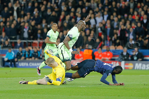 06.04.2016. Paris, France. UEFA CHampions League, quarter-final. Paris St Germain versus Manchester City.  Blaise Mathuidi (psg) fouled by Eliaquim Mangala (Manchester City FC) as Joe Hart (Manchester City FC) comes out to block