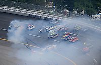 "Apr 26, 2008; Talladega, AL, USA; NASCAR Nationwide Series driver Carl Edwards (60) goes airborne after contact with Kevin Lepage (61) as David Reutimann (00) and Steve Wallace (66) spin during a multi car accident during the Aarons 312 at the Talladega Superspeedway. The crash was started when Lepage was exiting pit road and pulled up into the field going 100mph slower than the pack of cars going over 190mph. Initially Lepage blamed the other drivers for not going around him but  ""After reviewing the tapes of the accident I realize I need to apologize to NASCAR, the car owners, my fellow competitors and, most importantly, the fans,"" he said in a statement released by his team, Specialty Racing. ""I made a huge driver error by blending onto the race track in the wrong area. This caused a multicar accident and changed the outcome of the race for many teams..Mandatory Credit: Mark J. Rebilas"