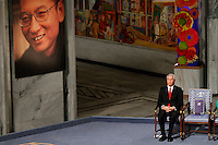 The Norwegian Nobel Committee decided to award.the Nobel Peace Prize for 2010 to Liu Xiaobo. Leader of the Norwegian Nobel Committee Thorbjørn Jagland elaborated on their decision to award the prize to Xiaobo during the ceremony in Oslo Town Hall. .Liu Xiaobo is imprisoned and no immediate family was permitted to leave China to accept the prize, so a chair was left empty and the medal and diploma placed there...Photo: Fredrik Naumann/Felix Features