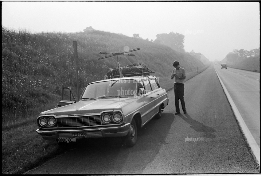 Bill Greeley getting ready to take a photo next to our car. On the Road somewhere in Pennsylvania heading west in 1973.