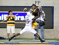 Bryce Treggs of California tries to catch a pass from Jared Goff during the game against Northwestern at Memorial Stadium in Berkeley, California on August 31st, 2013.  Northwestern defeated CAL, 44-30.