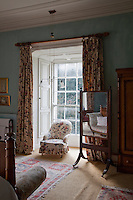 The chair in the bedroom is perfectly placed in the window alcove for views over the garden