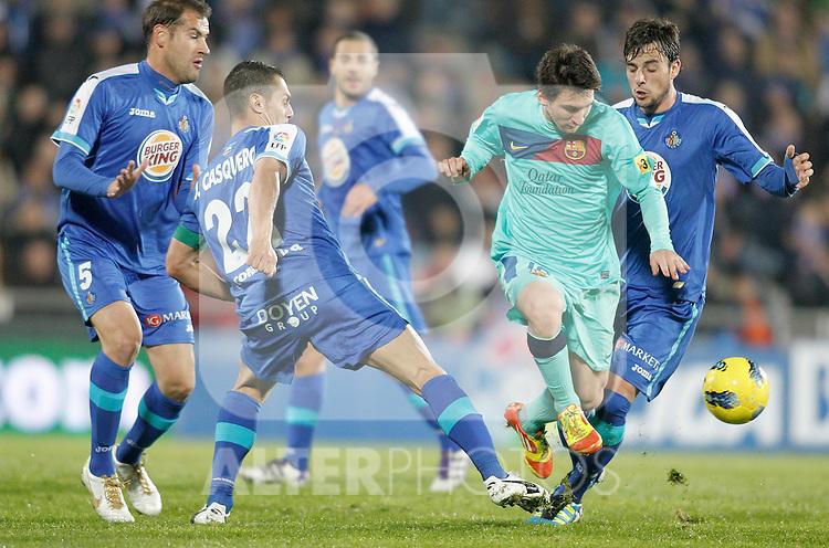 Getafe's Alberto Lopo, Javier Casquero and Michel Madera against Barcelona's Lionel Messi during La Liga match. November 27, 2011. (ALTERPHOTOS/Alvaro Hernandez)