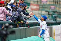 South Bend Cubs Christopher Morel (29) gives a ball to a fan after a Midwest League game against the Cedar Rapids Kernels at Four Winds Field on May 8, 2019 in South Bend, Indiana. South Bend defeated Cedar Rapids 2-1. (Zachary Lucy/Four Seam Images)