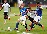 4th July 2020; Craven Cottage, London, England; English Championship Football, Fulham versus Birmingham City; Tom Cairney of Fulham being challenged by Maxime Colin and Maikel Kieftenbeld of Birmingham City