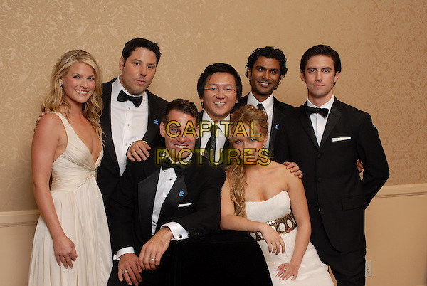 "ALI LARTER, GREG GRUNBERG, ADRIAN PASDAR, MASI OKA, HAYDEN PANETTIERE, SENDHIL RAMAMURTHY & MILO VENTIMIGLIA.Pressroom - 64th Annual Golden Globe Awards, Beverly Hills HIlton, Beverly Hills, California, USA..January 15th 2007. .globes press room half length bow tie white cream plunging neckline dress strapless black suit tuxedo heroes.CAP/AW.Please use accompanying story.Supplied by Capital Pictures.© HFPA"" and ""64th Golden Globe Awards"""