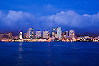 View from the ocean of Aloha Tower Marketplace and the city lights of downtown Honolulu