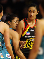 Thunderbirds goal defence Mo'onia Gerrard marks Maria Tutaia a little too closely during the ANZ Netball Championship match between the Waikato Bay of Plenty Magic and Adelaide Thunderbirds, Mystery Creek Events Centre, Hamilton, New Zealand on Sunday 19 July 2009. Photo: Dave Lintott / lintottphoto.co.nz