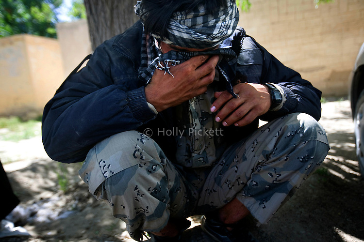 Attullah, 20, weeps outside the morgue while his brother and fellow border policeman Hamidullah's body is prepared for burial at the Mirwais Hospital morgue in Kandahar, Afghanistan, April 23, 2009. The day before, Ahmad Shei, 25, and Hamidullah, 22, were in an unarmored truck carrying material to a checkpoint in Zabul Province when their vehicle was hit by a roadside bomb. Four other border policemen were injured and taken to Kandahar Air Field to receive medical treatment. The two dead were to the morgue at Mirwais Hosptal before being transported to their home provinces in the North for burial. Despite worsening security, development continues at Mirwais Hosptial, where the International Committe of the Red Cross conducts training and assists the local staff. Mirwais is the main public hosptial serving five southern provinces. As security has deteriorated in the South, many international NGO's have pulled their staff from the area or shut down the regional office, stunting development in a region where it is badly needed.