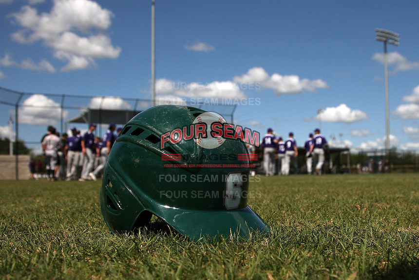 Slippery Rock helmet laying in the grass after a game against the Winona State Warriors at Lake Myrtle Complex on March 15, 2012 in Auburndale, Florida.  Winona defeated Slippery Rock 10-3.  (Mike Janes/Four Seam Images)