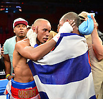 MIAMI, FL - JULY 10: Rances Barthelemy (black short) and Argenis Mendez (red short) in the ring fighting at the Iron Mike Judgement Day boxing match. Barthelemy won a unanimous decision over Mendez and captured the International Boxing Federation junior-lightweight title. at AmericanAirlines Arena on July 10, 2014 in Miami, Florida.  (Photo by Johnny Louis/jlnphotography.com)