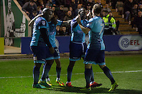 Myles Weston of Wycombe Wanderers (second right) celebrates scoring his side's third goal with Garry Thompson during the Sky Bet League 2 match between Plymouth Argyle and Wycombe Wanderers at Home Park, Plymouth, England on 26 December 2016. Photo by Mark  Hawkins / PRiME Media Images.