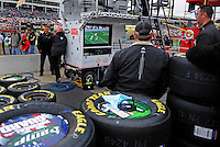 Oct. 17, 2009; Concord, NC, USA; Crew members for NASCAR Sprint Cup Series driver Dale Earnhardt Jr watch the college football game between USC and Notre Dame in their pit box prior to the NASCAR Banking 500 at Lowes Motor Speedway. Mandatory Credit: Mark J. Rebilas-