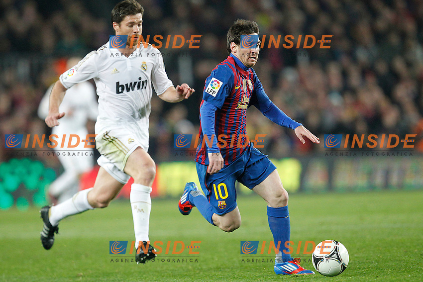 Barcelona's Lionel Messi and Real Madrid's Xabi Alonso during Spain's Kings Cup on January 25th 2012Barcellona Real Madrid 2-2  Coppa del Re .foto Insidefoto / Cesar Cebolla / Alterphotos .Italy Only