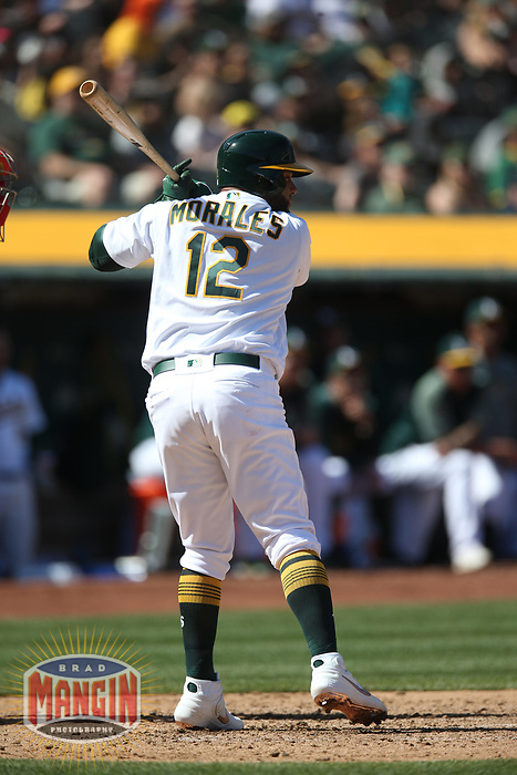OAKLAND, CA - MARCH 31:  Kendrys Morales #12 of the Oakland Athletics bats against the Los Angeles Angels during the game at the Oakland Coliseum on Sunday, March 31, 2019 in Oakland, California. (Photo by Brad Mangin)