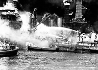 Pearl Harbor, taken by surprise, during the Japanese aerial attack.  USS WEST VIRGINIA aflame.  December 7, 1941.  (Navy)<br /> NARA FILE #:  080-G-19947<br /> WAR &amp; CONFLICT BOOK #:  1137