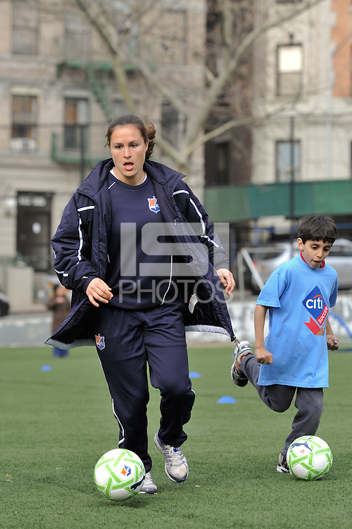 Kendall Fletcher of Sky Blue FC dribbles the ball  during a Women's Professional Soccer (WPS) soccer clinic at PS 192 in Harlem, NY, on April 7, 2011.