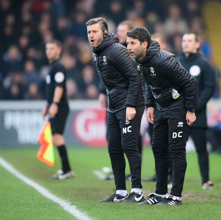 Lincoln City's assistant manager Nicky Cowley, left, and Lincoln City manager Danny Cowley shout instructions to their team from the technical area<br /> <br /> Photographer Chris Vaughan/CameraSport<br /> <br /> The EFL Sky Bet League Two - Lincoln City v Mansfield Town - Saturday 24th November 2018 - Sincil Bank - Lincoln<br /> <br /> World Copyright © 2018 CameraSport. All rights reserved. 43 Linden Ave. Countesthorpe. Leicester. England. LE8 5PG - Tel: +44 (0) 116 277 4147 - admin@camerasport.com - www.camerasport.com