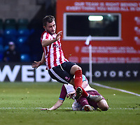 Lincoln City U18's Elliott Sartorius is tackled by South Shieldsy U18's Will McCamley<br /> <br /> Photographer Andrew Vaughan/CameraSport<br /> <br /> The FA Youth Cup Second Round - Lincoln City U18 v South Shields U18 - Tuesday 13th November 2018 - Sincil Bank - Lincoln<br />  <br /> World Copyright © 2018 CameraSport. All rights reserved. 43 Linden Ave. Countesthorpe. Leicester. England. LE8 5PG - Tel: +44 (0) 116 277 4147 - admin@camerasport.com - www.camerasport.com